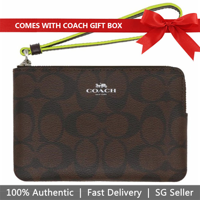 Coach Corner Zip Wristlet In Signature Canvas Brown / Neon Yellow / Silver # F39213